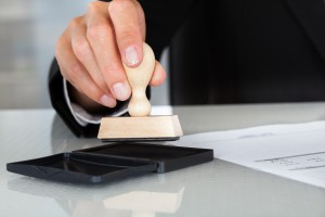 Business Man Hand With Rubber Stamp